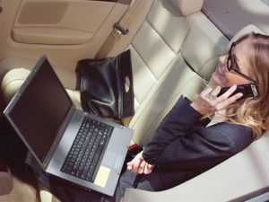 Businesswoman in a Limo - Phoenix Limo Rates