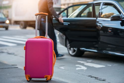 How do I make a reservation for the airport car service at my destination city