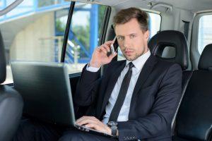 businessman in the car - corporate bus charter phoenix
