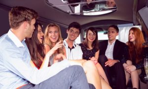 friends chatting in a limo - limo service Scottsdale